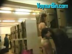 Two randy teen changing in a locker room on hidden cam