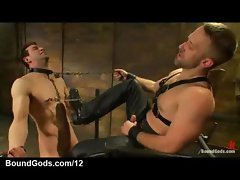 Bound gay gets tit torment and penis jerked off in dungeon