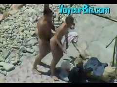 Couple caught banging on the beach