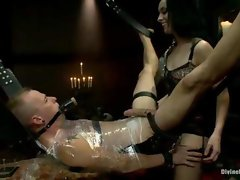 Divine Vixens Mistress January Seraph utterly tortures her slave even biting his balls