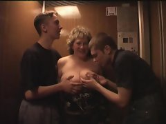 Enormous tits attractive mature cock sucking in the lift