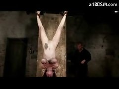 Big titted Tattooed Lass Mouthgag Hanging With Legs Up Nipples Tortured Whipped In The Dungeon