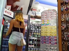 Candid voyeur hot latina ass in booty shorts shopping