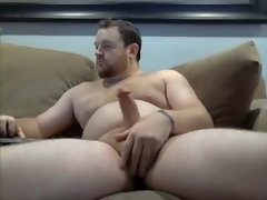 Handsome big cock daddy hairy man stroking his pink cigar and railing a fake penis